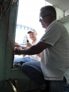 Tony and Hobie work on the door to the upper deck