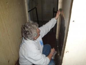 Lauren prepping walls of fidley.