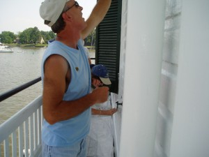 Photo by Anne Puppa Jeff painting one side of the lighthouse.