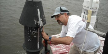 Photo by Hobie Statzer Henry installs brakets on vent