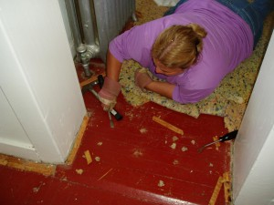 Trez pulls up old carpet.