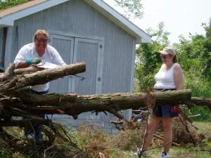 Trez and Sandra cut up the fallen cedar tree.