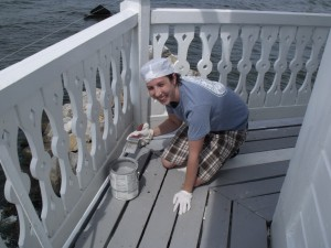 Abby Colangelo paints the outer deck boards.
