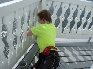 Cory Talbott paints Outer Deck Boards