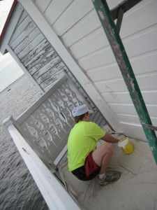 Photo by Tony Pasek Cory Talbott paints exterior siding