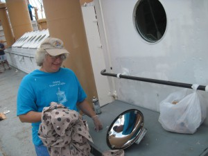 Photo by Tony Pasek Paula helps clean the mirror.