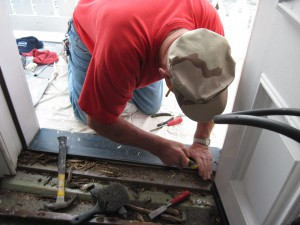 Photo by Tony Pasek Al Pearson works on sitting room door threshold.