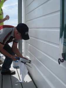 Photo by Tony Pasek Hobie caulks siding