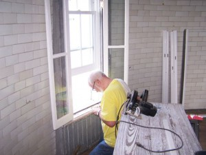 Photo by Robert Holland Al Smith works on window frame at Hooper Island Light