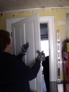 Photo by Tony Pasek Kathryn Crossin preps door for painting.