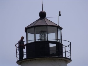 Photo by Tony Pasek Volunteer works on cupola of Concord Point.