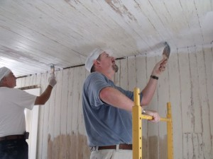 Photo by Tony Pasek Ray Brown and Shawn Saez paint sitting room ceiling.