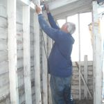 Photo by Hobie Statzer Howard dismantles shed
