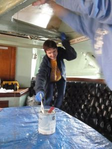 Photo by Barbara Witucki Student volunteer Aidan paints wardroom ceiling.