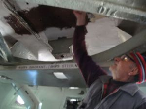 Photo by Anne Puppa Tony puts primer on ceiling.