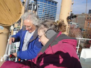 Photo by Anne Puppa Lauren and Heidi hang lights.