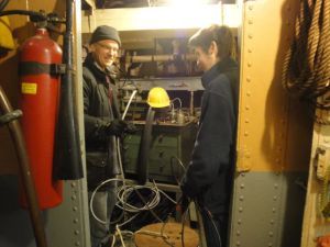 Photo by Susan Duke Andy and Aiden work on wiring in drill press room.