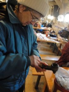 Photo by Anne Puppa Barbara Witucki reassembles handset.