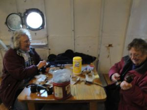 Photo by Anne Puppa Lauren and Heidi clean phone handsets.