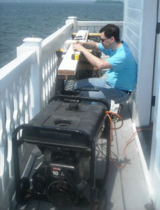 Karl working on deck board.