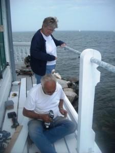 Howard and Cathy Lewis work on railings.