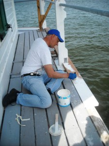 Tony working on deck board recently replaced.