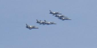 Blue Angels practice overhead.
