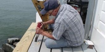 Hobie replacing deck boards.