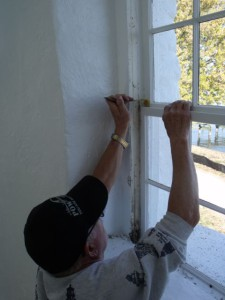 Hobie repairs window pain on tower.