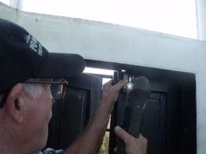 Hobie installs latch on cupola hatch.