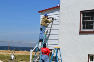 Tony and Joan work on final touch on the side of the addition .