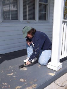 Anne Scraping porch to visitor cener