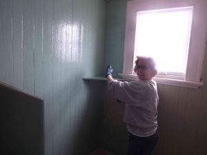 Cory paints dormer sea foam.