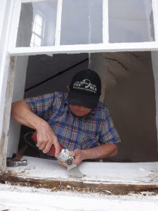 Hobie working on window.
