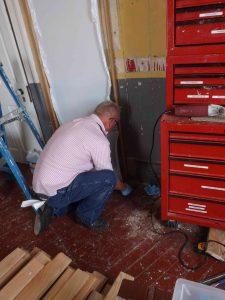 Hobie working on equipment room display.