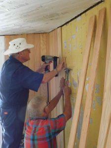Bob and Hobie installing paneling.