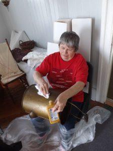 Virginia Crespo polishes an artifact