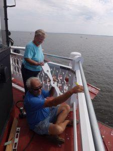 Cathy & Captain Howard work on new cupola railing