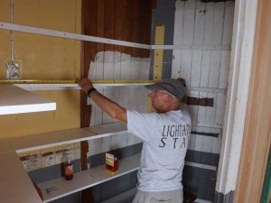 Dick continues work on closet.