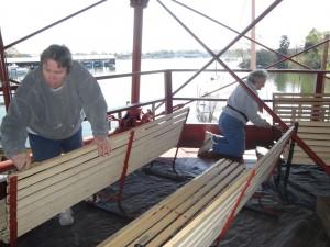 Carolyn and Paula scraping benches