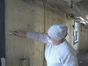 Photo by Anne Puppa.  Alma painting one of the walls.