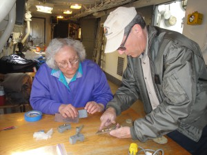 photo by Anne Puppa  Greg instructing Paula on work to be done.