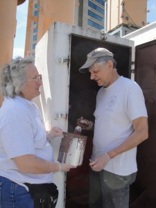 Photo by Anne Puppa  Tony and Lauren paint damage control locker.