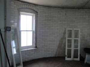 Photo by Anne Puppa WIndows and interior shutters in light.