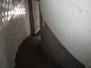 Photo by Anne Puppa Stairwell. Note the iron Plate attached to interior wall.