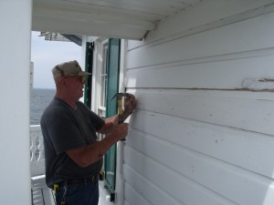 All Pearson secures new siding board.