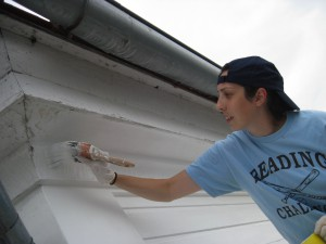 Photo by Tony Pasek Abby Colangelo paints eaves.