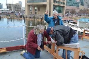 Barbara Lauren and Hobie work on boat davit.