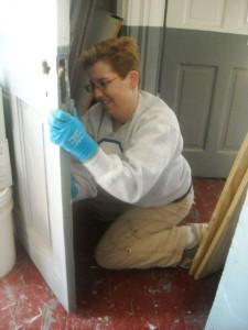 Photo by Hobie Statzer: Cory Talbott working on door.
