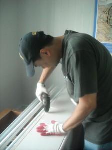 Photo by Hobie Statzer. Keast & Hood volunteers work on cable enclosure.